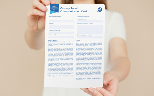 woman holding ostomy travel communication card A4 in her hands